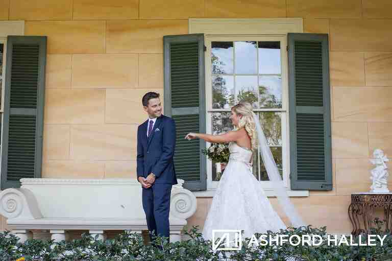 Groom seeing bride the first time during first look at Houmas House Plantation
