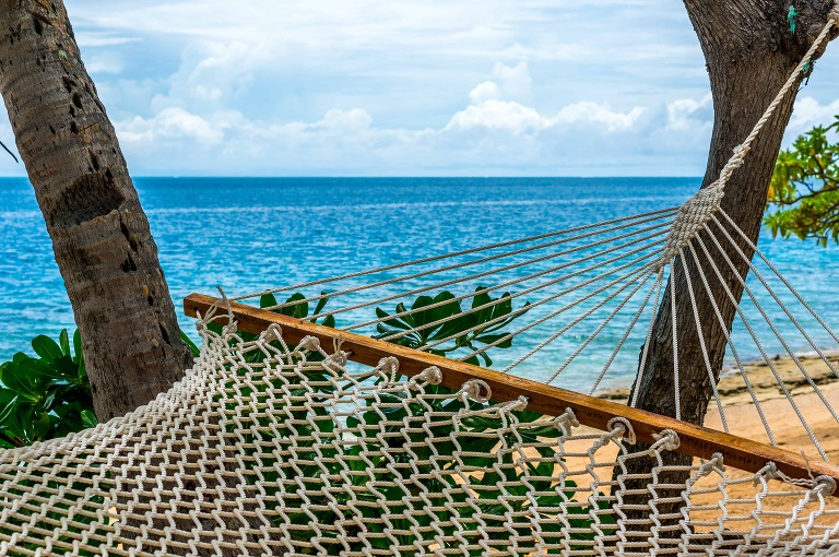honeymoon paradise with view of hammock and ocean